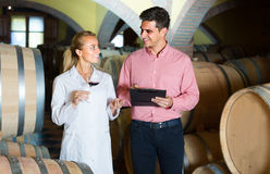 Male talking with technician. Male owner of winery working with technician in cellar Stock Photos