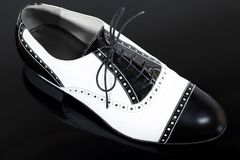 Male tango shoe. On the black Stock Images