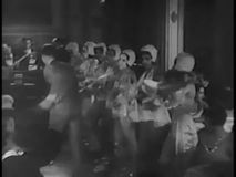 Male tap dancer joining female dancers in nightclub, 1930s stock video
