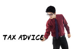Male tax consultant with tax advice. Handsome entrepreneur as a tax consultant writes a text of tax advice on whiteboard, isolated on white Royalty Free Stock Photography
