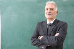 The Male Teacher in the classroom. Royalty Free Stock Photos