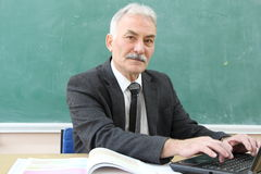 The Male Teacher in the classroom. Royalty Free Stock Image
