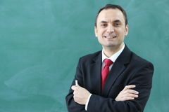 The Male Teacher in the classroom. The Turkish Teacher in the classroom in front of Royalty Free Stock Image