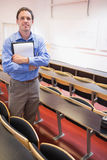 Male teacher with notepad in the lecture hall Stock Photos