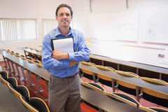 Male teacher with notepad in the lecture hall Royalty Free Stock Photo
