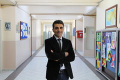 The Male Teacher in the school corridor. Stock Photo