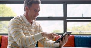 Male teacher using digital tablet. At school stock video