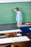 Male Teacher Writing On Greenboard Royalty Free Stock Photography