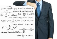 male teacher writing various high school maths and science formula on whiteboard royalty free stock photos