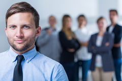 Male team leader. And group of people in background Royalty Free Stock Photography