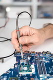 Male tech tests electronic equipment Royalty Free Stock Photos