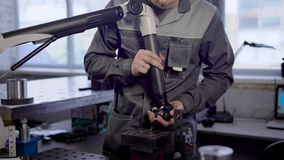 Male technician is checking and controlling quality of finished products of plant in a laboratory, measuring parameters
