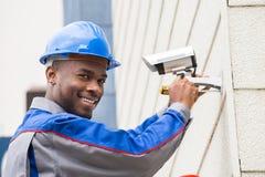 Male Technician Repairing Camera Stock Photos