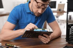 Male technician repairing computer at table royalty free stock images