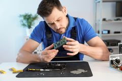 Male technician repairing hard drive at table royalty free stock photo