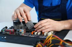 Male technician repairing motherboard at table royalty free stock photos