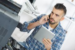 Male technician using digital tablet. Tablet Royalty Free Stock Image