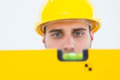 Male technician using spirit level Royalty Free Stock Photo