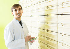 Male technician working in pharmacy depot. Positive english male technician working in pharmacy depot Royalty Free Stock Images