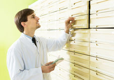 Male technician working in pharmacy depot Royalty Free Stock Photo
