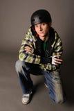 Male teen in helmet. Young male teen in helmet, studio shot Stock Image