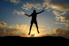 Male teen jumping in sunset. Sky on hill Royalty Free Stock Photo