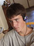 Male teen listening to music  Royalty Free Stock Images
