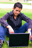Male teen typing in laptop. Latino Teen typing in laptop outdoors fun Stock Photos