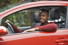 Male Teenage Driver Looking Out Of Car Window. Portrait Of Male Teenage Driver Looking Out Of Car Window Royalty Free Stock Photography