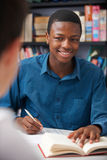 Male Teenage Pupil Working In Classroom. Male Teenage Student Works In Classroom Royalty Free Stock Photos