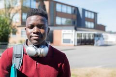 Portrait Of Male Teenage Student Outside College Building Wearin royalty free stock image