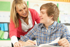 Male Teenage Student Studying In Classroom royalty free stock photography