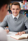 Male Teenage Student Working In Classroom Royalty Free Stock Image