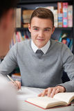 Male Teenage Student Working In Classroom. Male Teenage Student Works In Classroom Stock Image