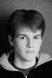 Male Teenager in Grayscale. Head shot of somber male teenager in grayscale Royalty Free Stock Photo