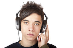 Male Teenager with headphone looking seriously Royalty Free Stock Images
