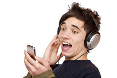 Male Teenager with headphones listens to mp3 music. And sings.Isolated on white background Royalty Free Stock Image