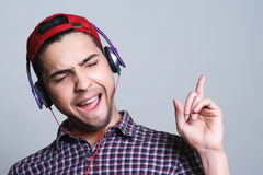 Male teenager with headphones in the studio the concept of musi. Male teenager with headphones in the studio, the concept of the musi Stock Photography