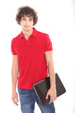 Male teenager with laptop - copy space. Young handsome man portrait in studio Royalty Free Stock Photography