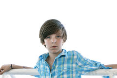Male teenager  leaning on a reeling Royalty Free Stock Images