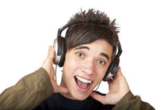 Male Teenager listening to music and sings loudly. Isolated on white background Stock Photos