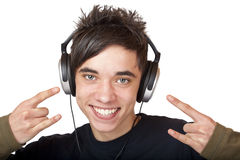 Male Teenager listening to music and smiles happy. Isolated on white background Royalty Free Stock Image
