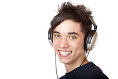 Male Teenager listening to music and smiles happy. Isolated on white background Stock Photos