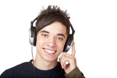 Male Teenager listening to music and smiles happy. Isolated on white background Stock Image