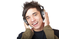 Male Teenager listening to music via headphone. And sings. Isolated on white background Stock Image