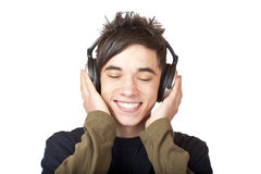 Male Teenager listening to music via headphone. Isolated on white background Stock Image