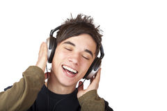 Male Teenager listening to music via headphones. Male Teenager listening to music via headphone and sings. Isolated on white background Royalty Free Stock Photos