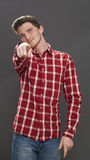 Male teenager pointing finger to denounce someone for blame Royalty Free Stock Image