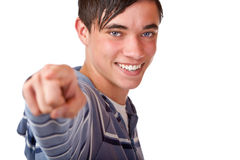 Male Teenager pointing with finger on you. Close-up of teenager pointing with finger on camera. Isolated on white Royalty Free Stock Image
