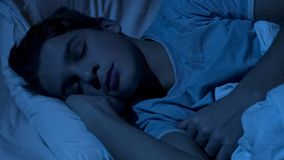 Male teenager sleeping healthy at night time, close-up of child face, relax. Stock photo royalty free stock photo